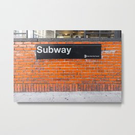 subway sign on a brick wall Metal Print
