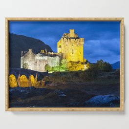 Eilean Donan Castle on a cloudy night lit with coloured lights Serving Tray