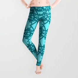 Braided openwork pattern of wire and blue arrows on a light blue background. Leggings