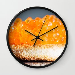 Sandwich with red caviar on a gray background Wall Clock