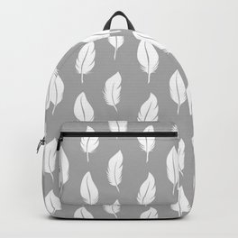 White feathers on a gray background. Backpack