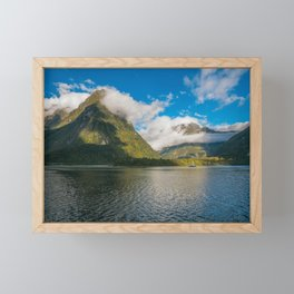 Spectacular mountain range surrounded by clouds close to sunset at Milford Sound Framed Mini Art Print