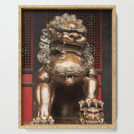 Lion bronze statue in front of a buddhist temple Serving Tray