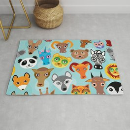 Seamless pattern cute face funny animals on blue background. Vector Rug