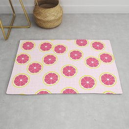 Cute Grapfruit on pink background Rug