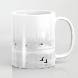 Canadian Geese flying formation  over the river through the fog Coffee Mug
