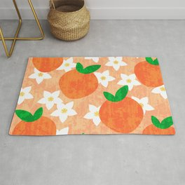 Tropical exotic oranges and white pretty orange blossoms fruity floral summer bright sunny light pastel peach color pattern design. Rug