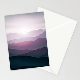 dark blue mountain landscape with fog and a sunrise and sunset Stationery Cards