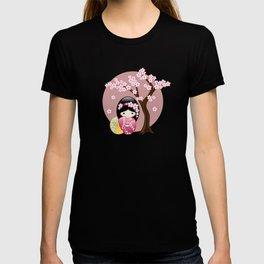Japanese Spring Kokeshi Doll on Pink T-shirt