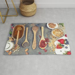 Breakfast set with granola, almond milk, superfoods and berries Rug
