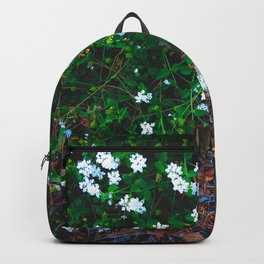 blooming white flowers with green leaves and dry leaves Backpack