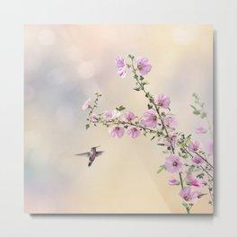 Humming bird and Hollyhock flowers in the garden Metal Print