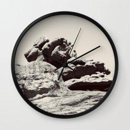 Boy on Rocks Wall Clock