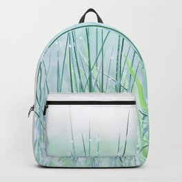 Field of grass in a fresh spring morning Backpack