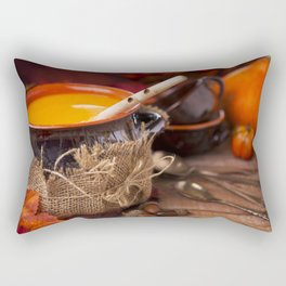 Homemade pumpkin soup on a rustic table with autumn decorations Rectangular Pillow