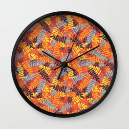 Leave Silhouettes blue, orange, yellow on red Wall Clock