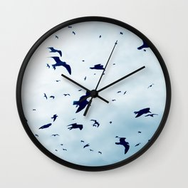 Free - Seagulls fly high up in the sky. Wall Clock