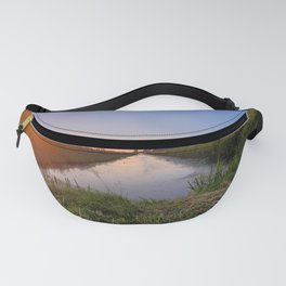 Sunset over the separated fields Fanny Pack