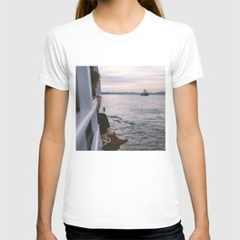 A beautiful girl enjoying Istanbul city view from the sea at sunset T-shirt