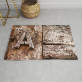 Weathered wood letter A Rug