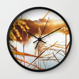 Sunset by a lake in Langensendelbach Wall Clock