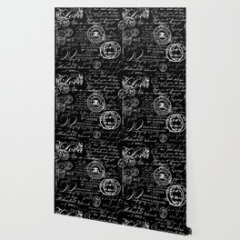 white vintage handwriting on black wallpaper