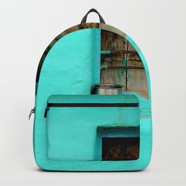 GRAY STEEL CONTAINER ON WINDOW WITH TEAL PAINT Backpack