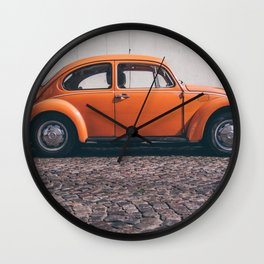 the orange one Wall Clock