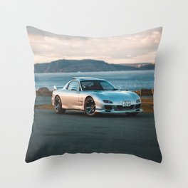 Silver rx7 parked during sunset Throw Pillow
