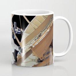 Astronaut Owen K Garriott Skylab 3 science pilot retrieves an imagery experiment from the Apollo Tel Coffee Mug