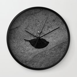 Single leaf in the water Wall Clock