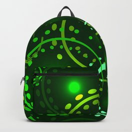 Metallic openwork rings in green hues on the ground background. Backpack