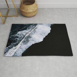 Waves crashing on a black sand beach – minimalist Landscape Photography Rug