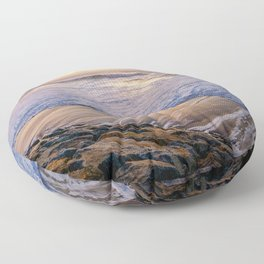 White waves crashing into mossy rocks, with a beautiful autumn sunset. Floor Pillow