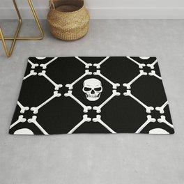 Skulls and bones white on black Rug