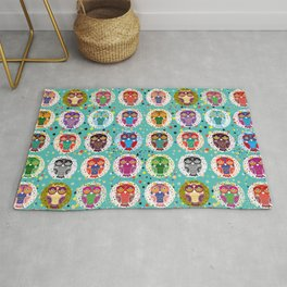 funny colored owls on a turquoise background Rug