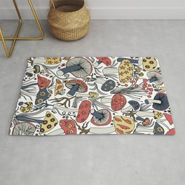 Hand-drawn mushrooms in muted blues, reds and yellows Rug