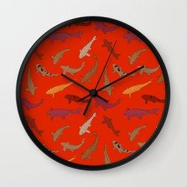 Koi carp. Brown orange yellow black outline on red background Wall Clock