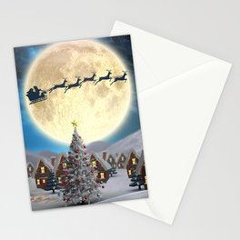 Christmas village night - Amazing cute christmas santa's sleigh goes through fantastic winter small town. Stationery Cards