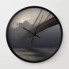 Bridge hidden in the fog at sunrise Wall Clock