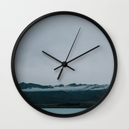 Lake tekapo - New Zealand -  Hot springs with a view on the mountains with ice & clouds  Wall Clock
