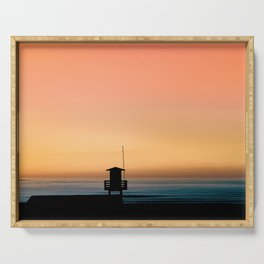 SILHOUETTE PHOTOGRAPHY OF A COTTAGE BY THE SEA DURING GOLDEN HOUR Serving Tray