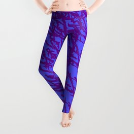 Braided geometric pattern of wire and green arrows on a dark background. Leggings