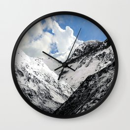 Snowy Mountains with Dramatic Clouds Wall Clock