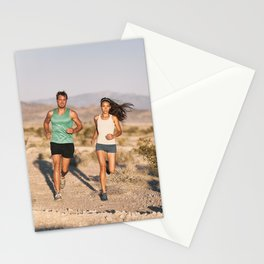Trail ultra runners man and woman athletes running for triathlon Stationery Cards