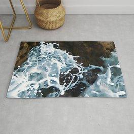 Elegant Sea Foam Splashing Against Coastal Rocks Rug
