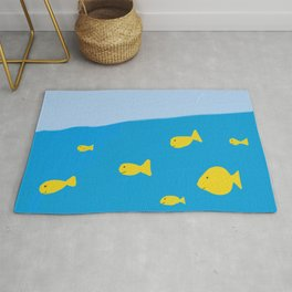 A school of cute yellow fish in the blue sea Rug