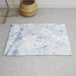 bloom in navy tone botanical art washed out effect aesthetic photography Rug