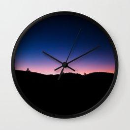 Pink blue sky Wall Clock