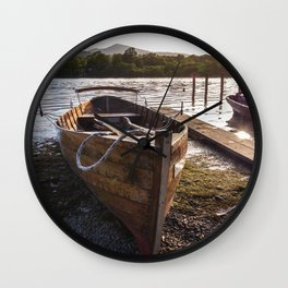 Wooden rowing boats on shore of Lake Derwentwater, England Wall Clock